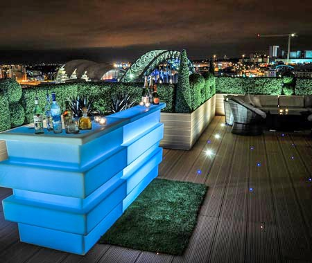 The blue bar on the roodtop of the Sky Lounge at night