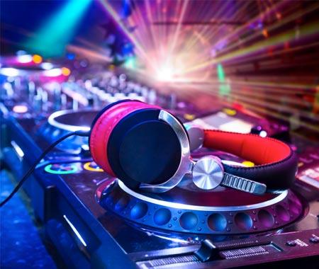Some headphones lying on a DJ