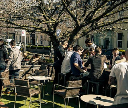People sat outside Osbornes in the beer garden, during the day