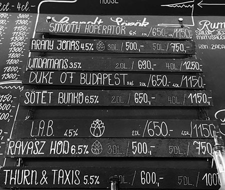 A blackboard with all of the craft beer selection on