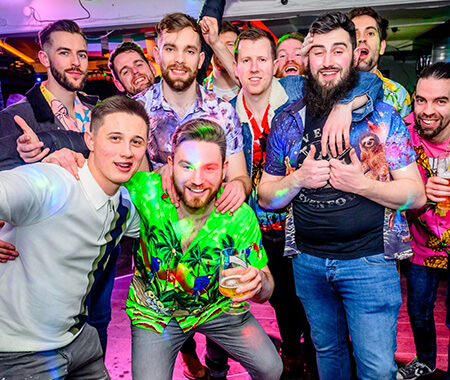 A group of men posing for a group photo in a bar