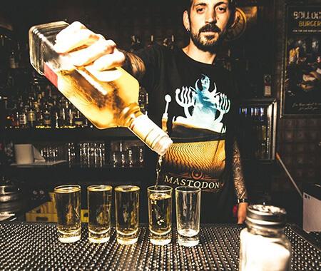 A bartender serving shots