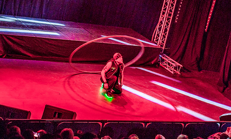 A man stood in a hula hoop on stage