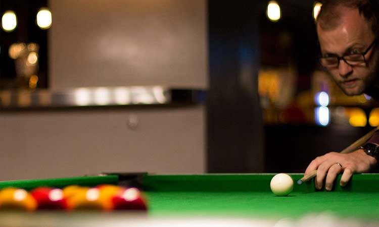 Close up of a man playing snooker