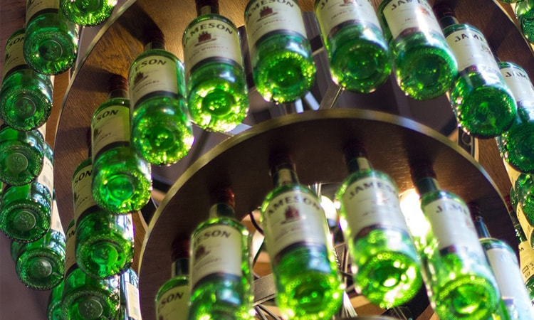 Jameson Whiskey bottles hung up on a chandelier at Jameson distillery