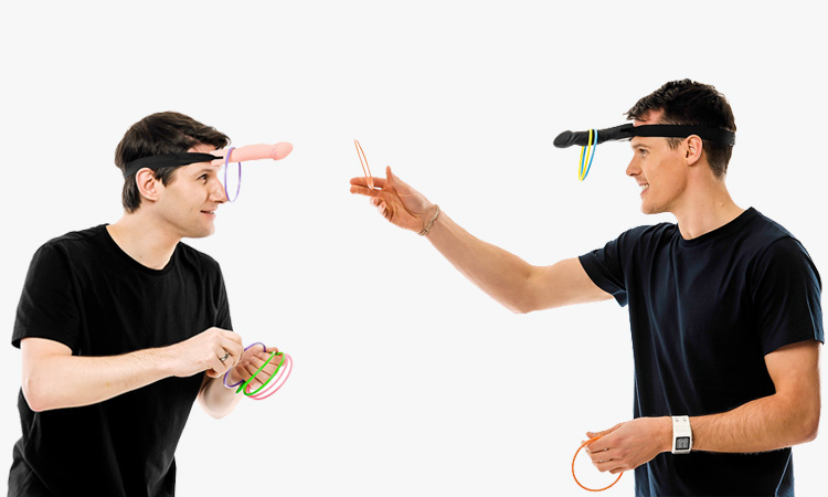 Two men playing dickhead hoopla