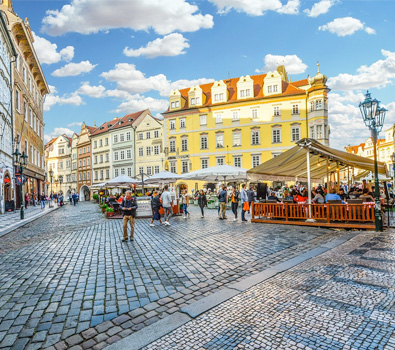 Prague's Old Town square with picturesque, colourful buildings overlooking it