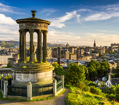 A monument in Edinburgh with a pretty view behind it