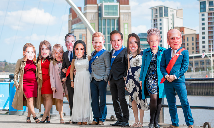 Last Night of Freedom staff members wearing masks of the Royal Family on Newcastle's Quayside