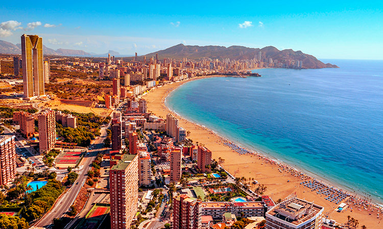 A view of the sun soaked Benidorm beach and famous skyscrapers