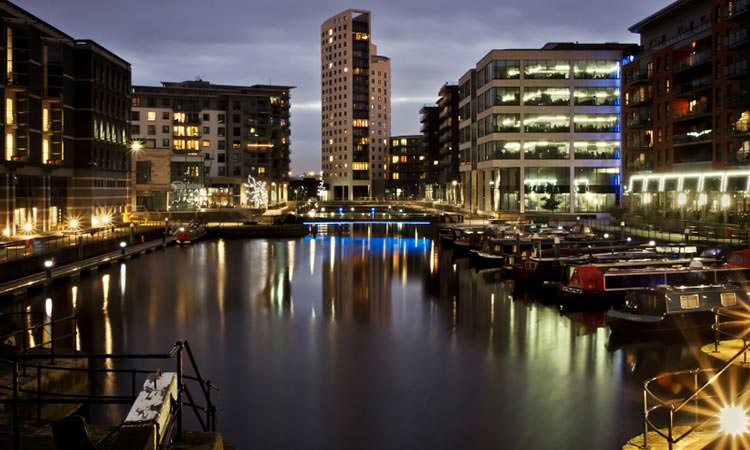 Boats docked at night in Leeds marina