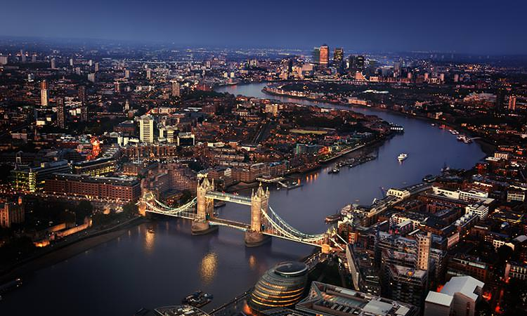 View over central London and the Thames river with London Bridge the central focus point of the photo.