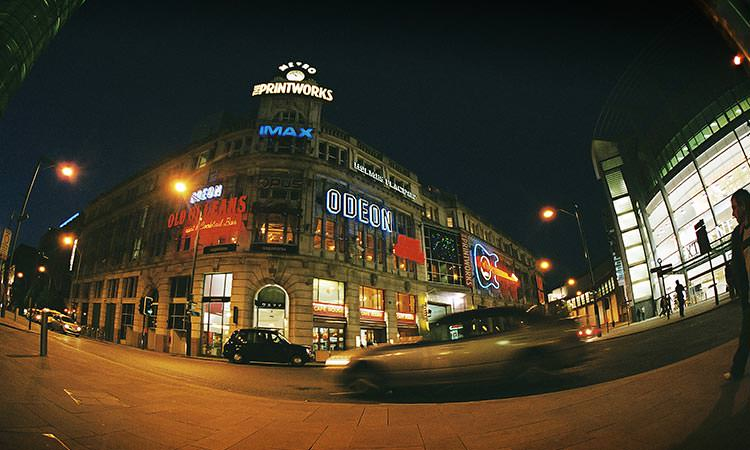 A Fisheye shot of the Printworks building in Manchester at night.