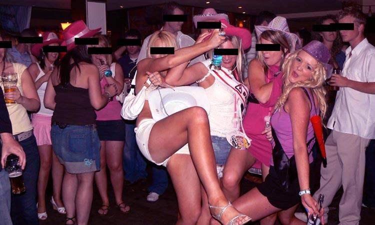 A group of women in cowboy hats having fun