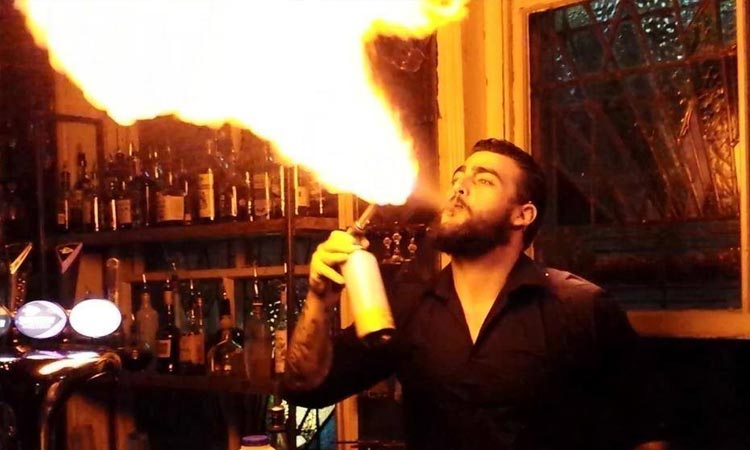 The barman in All Seeing Eye blowing fire with his mouth