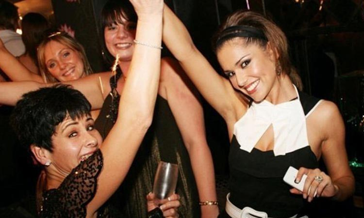 Cheryl Cole on a night out, dancing with some other women
