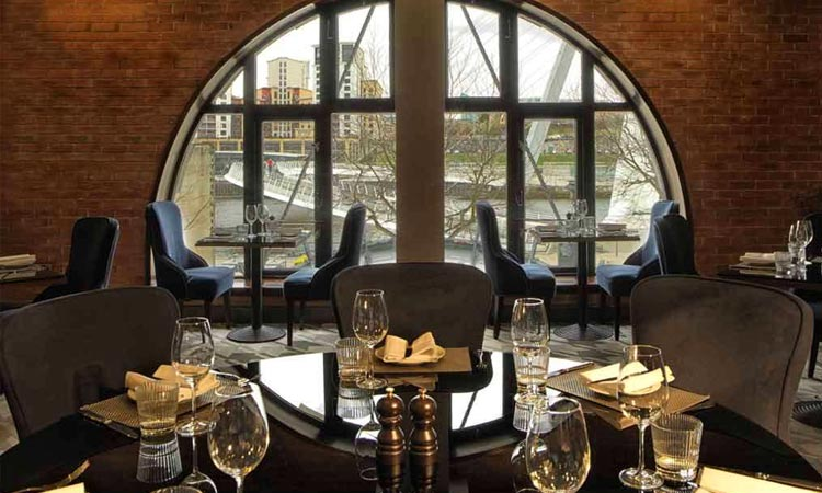 Chez Mal Bar with a table set overlooking The Quayside