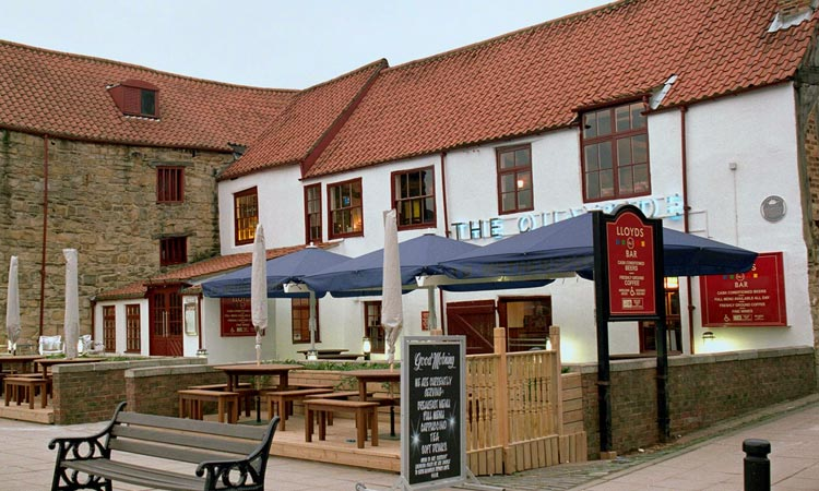 The exterior of The Quayside Wetherspoons with outdoor seating