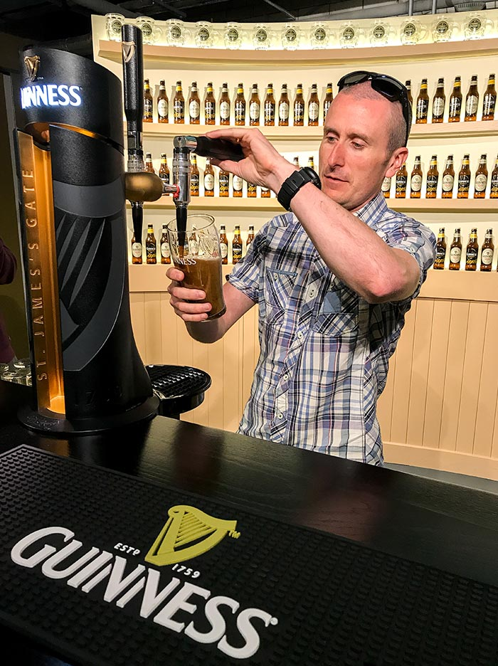 A man pulling a pint at the Guinness Factory