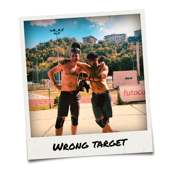 Two shirtless men after taking part in archery