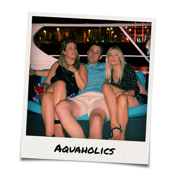 A man with his arms around two girls
