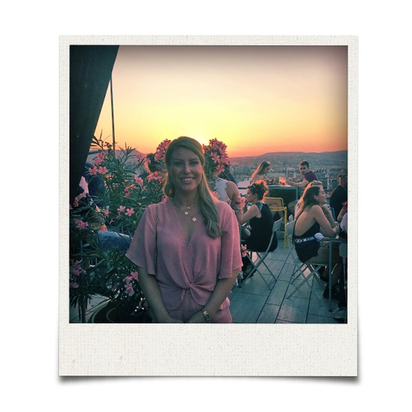 A woman in a pink dress in Budapest's 360 rooftop bar