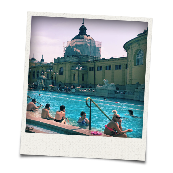 Some people sunbathing in Szechenyi Baths
