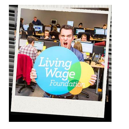 Matt holding a Living Wage sign