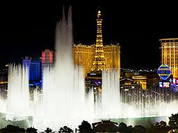 The Bellagio fountains display, with the replica Eiffel Tower of Paris Las Vegas in the background