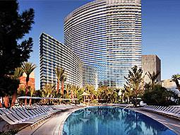 An outdoor pool and the exterior of the ARIA resort