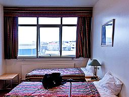 A twin room with large window