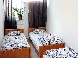 A bedroom in a Top One Apartments apartment