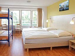 A light and airy room with two double beds and a bunk bed