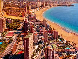 Aerial view of Benidorm sea front with hotels and beach in image