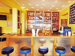 The bar area of A&O Hackerbruke, with blue bar stools