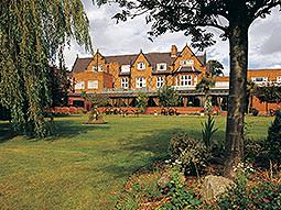 The grounds of the Brook Mollington Banastre Hotel and Spa, with the building exterior in the background