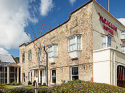 The exterior of Mercure Hotel, with exposed brickwork on the side