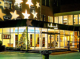The exterior of the Hallmark Hotel, Manchester, with stars lit up on the wall
