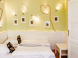 Some lighting in a bedroom, with the wires making hearts on the wall