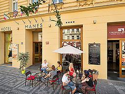 The yellow frontage of EA Hotel Manes in Prague