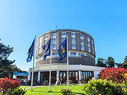 The Roundhouse Hotel in Bournemouth, with three flags in the foreground
