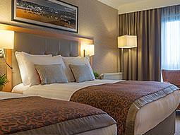 A guest room at the Clayton Hotel Cardiff Lane with a double bed