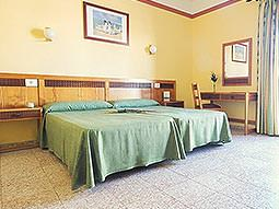 Guest bedroom at Azuline S'Anfora & Fleming Hotel