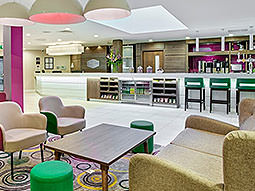 The bar and lobby area in Hampton by Hilton