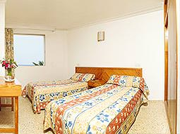 A guest bedroom at the Bon Sol Apartments