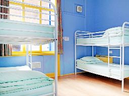 Two bunk beds in a room with blue and yellow decor