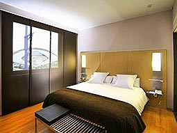 A double room with black and white bedding, to match the black and white walls