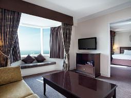 Sofa, coffee table and TV in a hotel suite