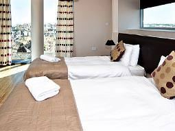 A bedroom with two twin beds at Millennium Walk Apartments