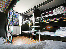 Bunk beds set into the walls, with a picture of an astronaut up on the wall